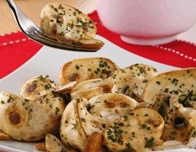 Champiñones con mantequilla y almendras