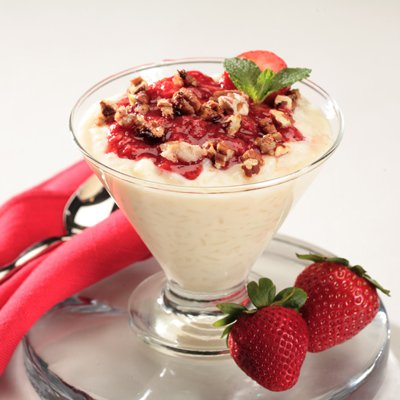 Arroz con Leche with Tangy Strawberry Sauce and Candied Pecans
