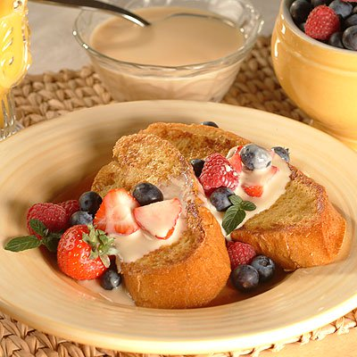 Dessert French Toast with Fresh Berries and Cinnamon Vanilla Sauce