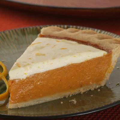 Zesty Cream Topped Orange Pumpkin Pie