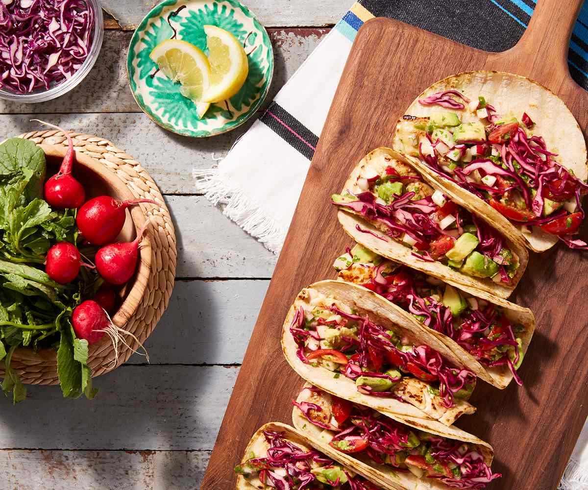 Fish Tacos with Avocado Radish Salsa and Pickled Cabbage