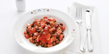 Kapucijners met spek, ui en tomaat
