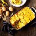Vegetarische prei-kerrie ovenschotel met courgette en kikkererwten