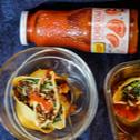 Muszle z serem i szpinakiem w sosie pomidorowym