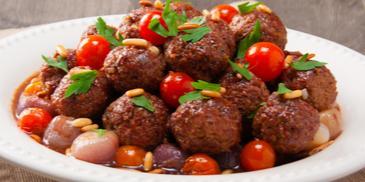 Kofta with groats and pomegranate sauce